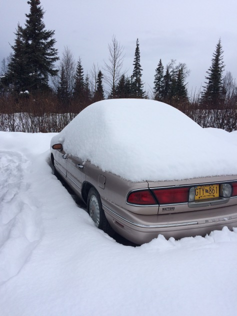 Papa Freds car parked at the trail head covered in snow